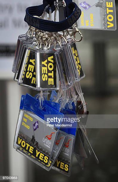 Unite Union member holds badges and key chains urging a no vote as British Airways cabin crew meet at Kempton Park Racecourse on February 25 2010 in...