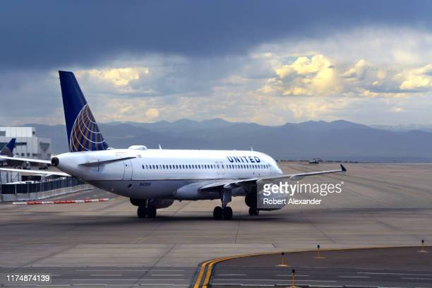 United Airlines Airbus A320 passenger jet taxis at Denver International Airport in Denver Colorado