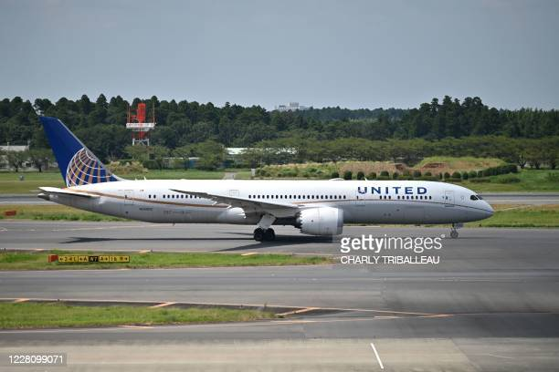 United Airlines aircraft prepares for take off at the Narita International Airport in Narita, Chiba Prefecture on August 19, 2020.