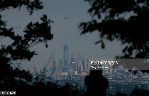 United Airlines airplane on approach to Newark Liberty Airport flies over Lower Manhattan in New York on June 18 2016 as seen from Montclair NJ