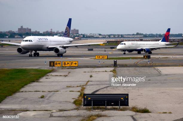 United Airlines and Delta Airlines passenger jet taxi at LaGuardia Airport in New York New York