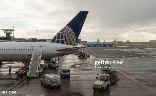 United Airlines and several KLM airplanes are parked on the tarmac in Schiphol Airport on April 23 2017 in Amsterdam Netherlands Schiphol is the main...
