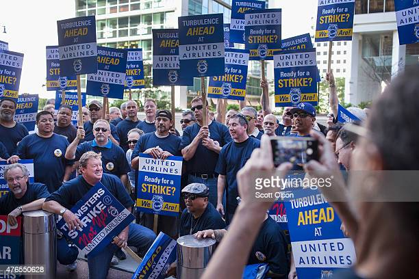 United Airlines aviation maintenance technicians and related support personnel demonstrate outside the company's annual shareholders' meeting at the...