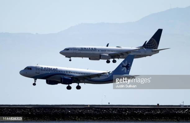 United Airlines Boeing 737 lands next to an Interjet Airbus A320 at San Francisco International Airport on April 24 2019 in San Francisco California...