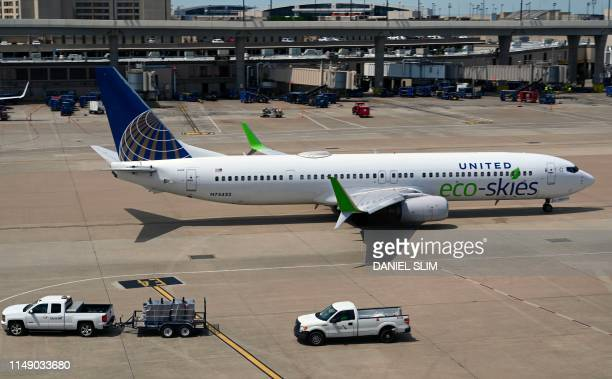 A United Airlines Boeing 737 with Eco Skies logo taxis at Dallas Fort Worth Texas on June 10 2019