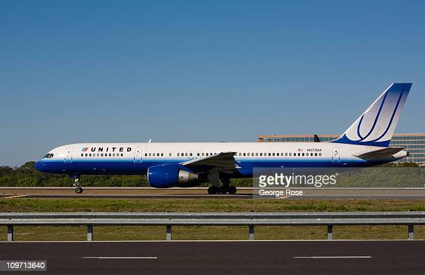 United Airlines Boeing 757 jet taxis on the runway of Tampa International Airport on February 14 2011 in Tampa Florida Hit hard by the recent...