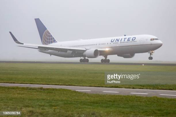 United Airlines Boeing 767-322 with registration N661UA landing at Amsterdam Schiphol International airport in the mist. United Airlines, is a Star...