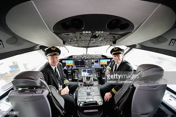 United Airlines Captain Stephen Kastner and First officer Mike McCann sit in the cockpit of the new Boeing 787 Dreamliner at Los Angeles...