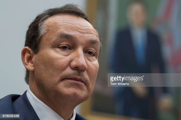 United Airlines CEO Oscar Munoz prepares to testify before a House Transportation and Infrastructure Committee hearing in Rayburn Building titled...