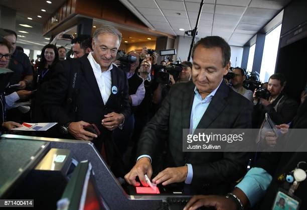 United Airlines CEO Oscar Munoz scans a boarding pass as a passenger boards United Airlines flight 747 for its final flight from San Francisco...