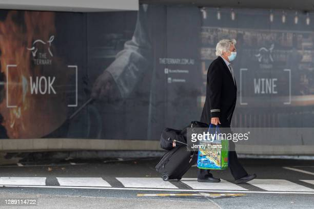 United Airlines crew member is seen arriving at the Novotel Hotel in Darling Harbour on December 03, 2020 in Sydney, Australia. NSW has recorded its...