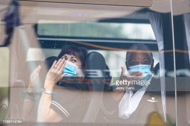 United Airlines crew members wave and blow kisses as they depart the Novotel Hotel in Darling Harbour on December 03, 2020 in Sydney, Australia. NSW...