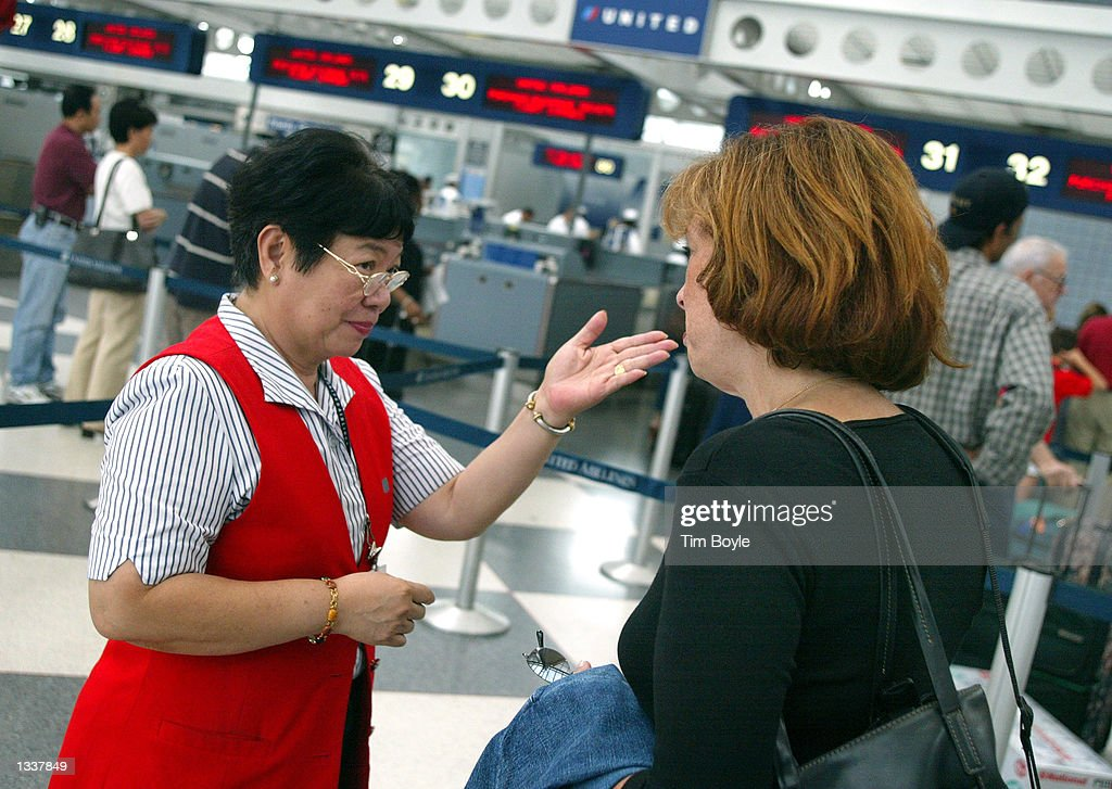 United Airlines Customer Service Clerk Yolanda Escobar Assists A Traveler  At Ou0027Hare International Airport