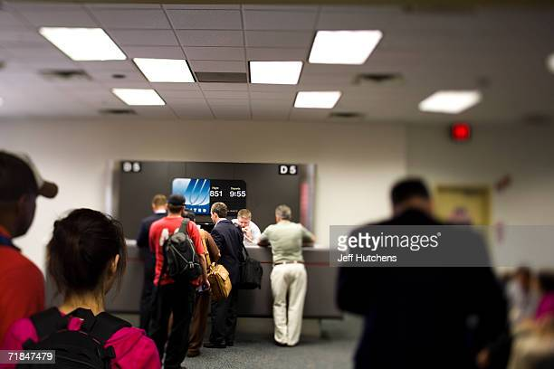 JUNE 28 2006 United Airlines customers line up for service at a Chicago OHare gate unhappy about the overbooking of a flight as airline passengers...