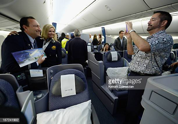 United Airlines flight attendant Tina Hernderson gets her picture taken with co workers while touring the new Boeing 787 Dreamliner at Los Angeles...