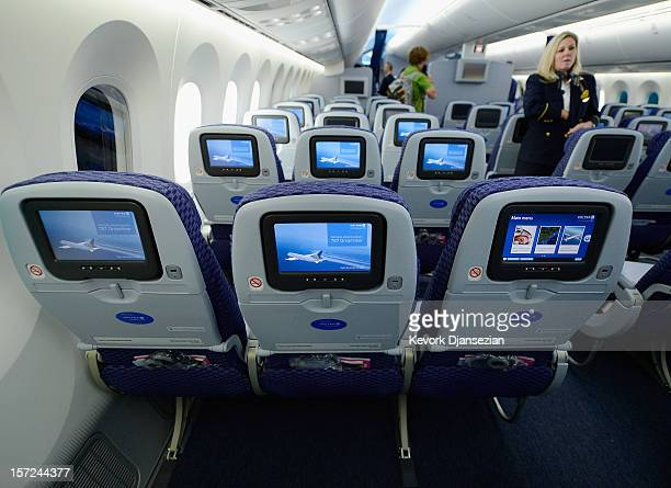 United Airlines flight attendant Tina looks at personal entertainment systems on the new Boeing 787 Dreamliner during a tour of the jet at Los...