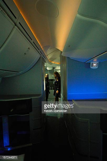 United Airlines flight attendants look at the LED cabin lighting as it changes colors on the United Airlines Boeing 787 Dreamliner at Los Angeles...