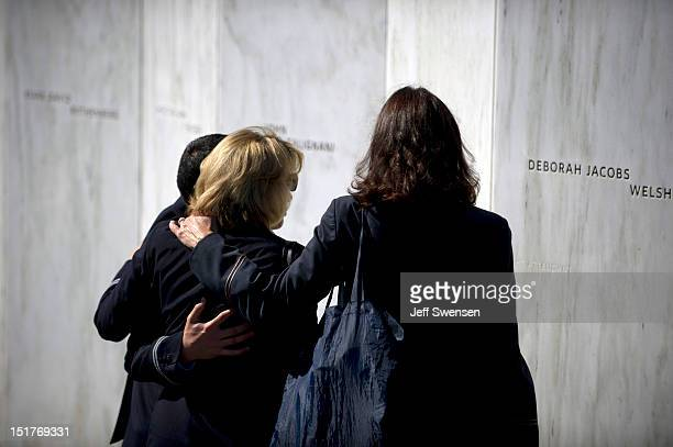 United Airlines flight attendents stand in front of of the Wall of Names at the Flight 93 National Memorial during observances commemorating the...