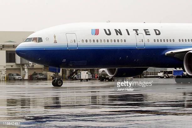 United Airlines Flight from Chicago lands at Los Angeles International Airport carrying the Oscar Statuettes for the 77th Annual Academy Awards to be...