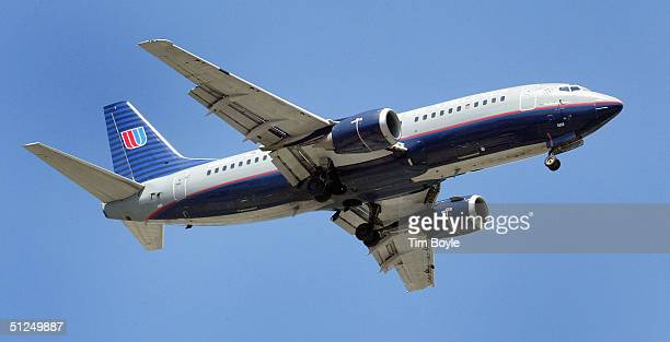 United Airlines jet heading to O'Hare International Airport in Chicago is seen in the skies August 31 2004 over Bensenville Illinois United Airlines...