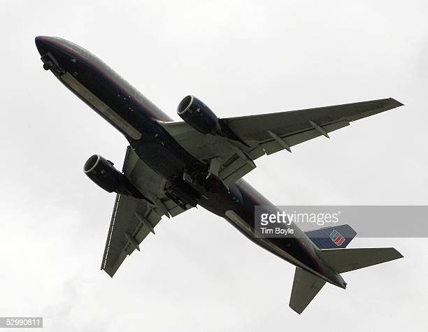 United Airlines jet retracts its wheels as it aborts a landing attempt May 27 2005 at O'Hare International Airport in Chicago Illinois Travelers are...