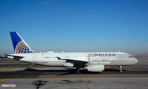 United Airlines passenger jet taxis at LaGuardia Airport in New York New York