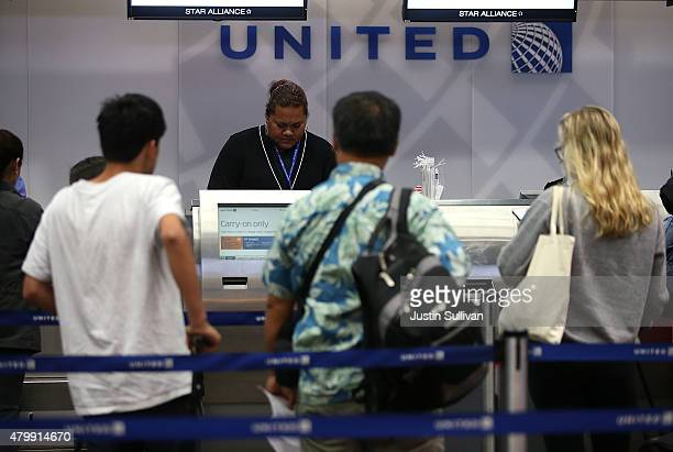 United Airlines passengers check in for flights at San Francisco International Airport on July 8 2015 in San Francisco California Thousands of United...
