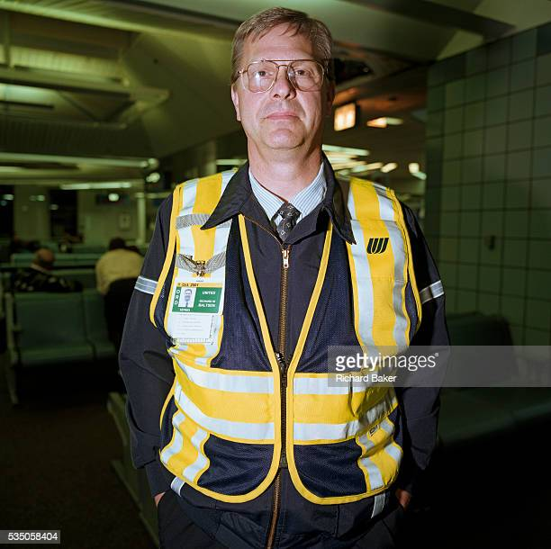A United Airlines ramp agent stands in the terminal building of Chicago O'Hare airport before continuing his airside shift dispatching and...