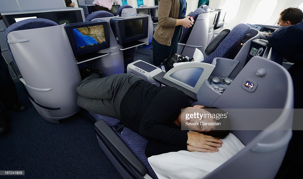 United Airlines sales manager Marilyn Jablonsky lay down in the reclining seats of Business First class while touring the new Boeing 787 Dreamliner at Los Angeles International Airport on November 30, 2012 in Los Angeles, California. In January the new jet is scheduled to begin flying daily non-stop between Los Angeles International airport and Japan's Narita International Airport and later to Shanghai staring in March. The new Boeing 787 Dreamliner will accommodate 219 travelers with 36 seats in United Business First, 70 seats in Economy Plus and 113 in Economy Class. The carbon-fiber composite material that makes up more than 50 percent of the 787 makes the plane more fuel-efficient.