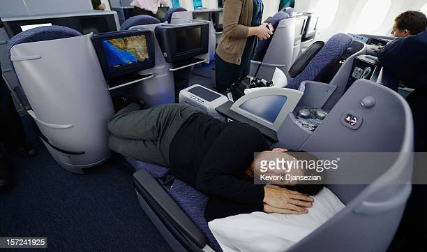 United Airlines sales manager Marilyn Jablonsky lay down in the reclining seats of Business First class while touring the new Boeing 787 Dreamliner...