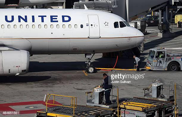 United Airlines sits on the tarmac at San Francisco International Airport on January 23 2014 in San Francisco California United Airlines parent...