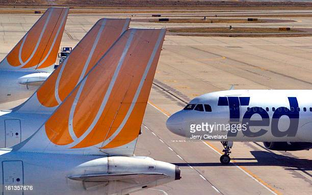 United Airlines Ted passenger jet eases up to a jetway at Concourse A at Denver International Airport Wednesday morning