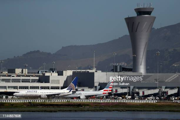 United and American Airlines Boeing 737s taxi on the runway at San Francisco International Airport on April 24 2019 in San Francisco California...