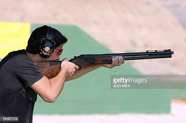 United Arab Emirate shooter Ahmad Dhahi prepares to fire during the double trap competition of the first day of the ISSF World Shooting Championships...