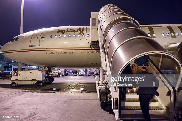 United Arab Emirates Abu Dhabi International Airport Etihad Airways airplane moveable boarding steps night