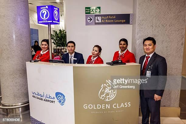 United Arab Emirates Abu Dhabi International Airport terminal concourse information desk Arabic English Golden Class man woman coworkers
