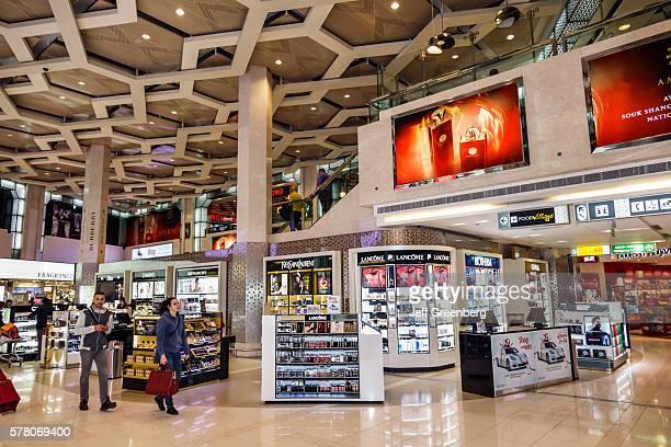 United Arab Emirates Abu Dhabi International Airport terminal concourse duty free shopping sale display cosmetics