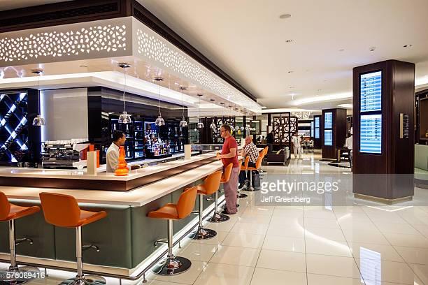 United Arab Emirates Abu Dhabi International Airport terminal concourse Etihad First Business Class Lounge bar pub