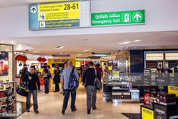 United Arab Emirates Abu Dhabi International Airport terminal concourse shopping Arabic English