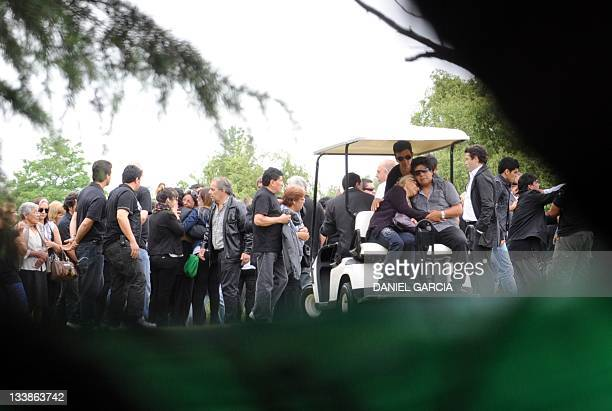 United Arab Emirates' Al Wasl football club coach Argentine former football star Diego Maradona family and friends attend the funeral of his...