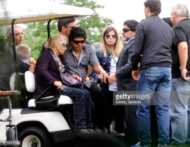 United Arab Emirates' Al Wasl football club coach Argentine former football star Diego Maradona next to his daughter Dalma and his brother Lalo...