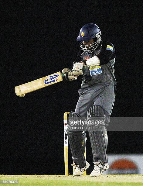 United Arab Emirates batsman Mohamed Tauqir plays a shot and misses with the ball behind the bat in the Match between India and United Arab Emirates...