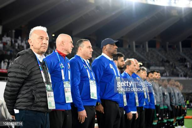 United Arab Emirates' coach Alberto Zaccheroni and his coaching staff sing the national anthem during the 2019 AFC Asian Cup Round of 16 football...