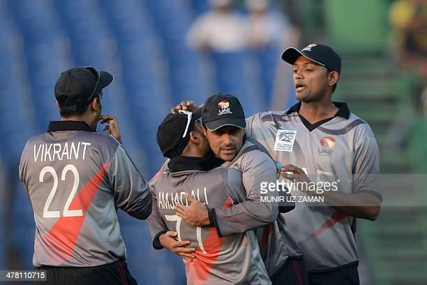 United Arab Emirates cricketer Amjad Ali celebrates with team captain Khurram Khan after the dismissal of Bangladesh cricketer Anamul Haque during...