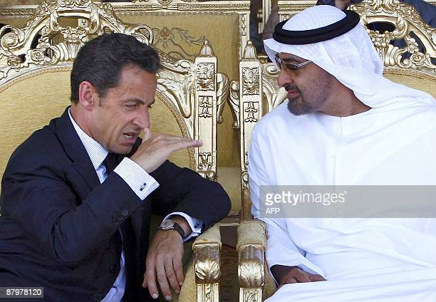 United Arab Emirates' Crown Prince Sheik Mohamed bin Zayed Al Nahyan and French President Nicolas Sarkozy chat on the tarmac of the Dhafra Air Base...