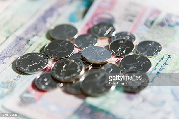 United Arab Emirates Currency, Coins and Bills in a Pile. Dubai, United Arab Emirates