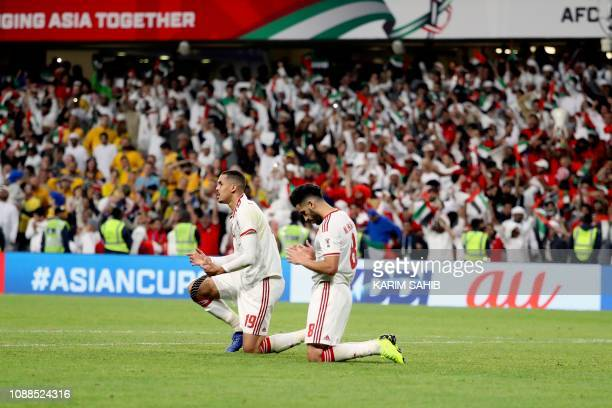 United Arab Emirates' defender Ismail Ahmed and United Arab Emirates' midfielder Majed Hassan kneel in prayer after their victory during the 2019 AFC...