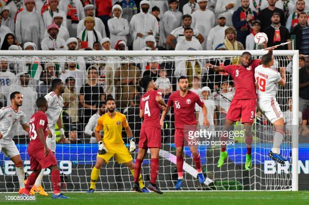 United Arab Emirates' defender Ismail Ahmed vies for the header with Qatar's defender AbdelKarim Hassan during the 2019 AFC Asian Cup semifinal...