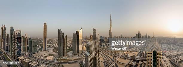 United Arab Emirates, Dubai City, Interchange at Sheikh Zayed Road with the Burj Khalifa at sunset