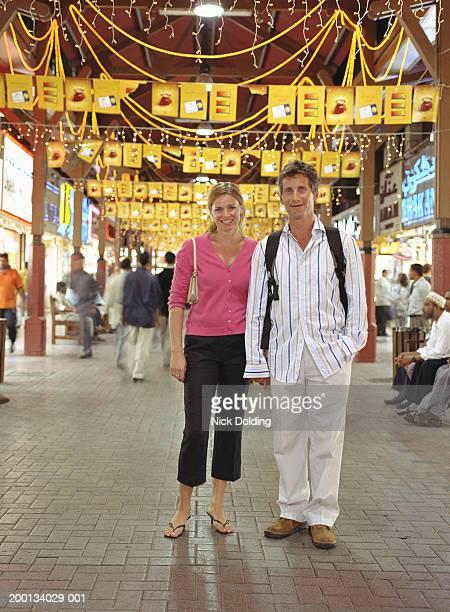 United Arab Emirates, Dubai, couple in the Gold Souk, portrait